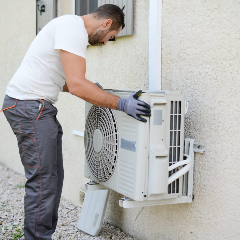 contractor performing hvac service on private house